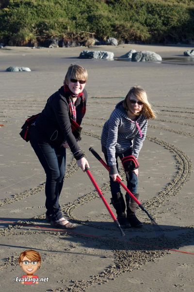 image of mother and daughter creating a labyrinth on the beach