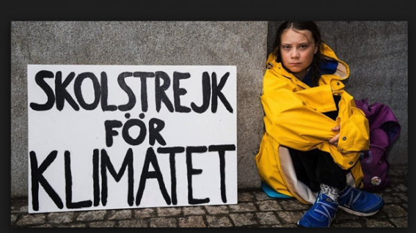 "Image of youth activist Greta Thunberg with her sign ""Skolstrejk for Klimatet"""